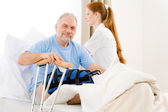 Hospital - female nurse care patient broken leg — Stock Photo