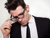 Young Businessman holding black glasses — Stock Photo