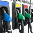 Pumps at gas station in a row - Stock Photo
