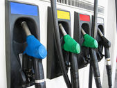 Pumps at gas station in a row — Stock Photo
