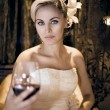 Girl blonde with glass of wine — Stock Photo