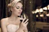 Portrait of beautiful woman with glass red wine — Stock Photo