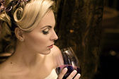 Beautiful young lady drinking red wine — Stock Photo