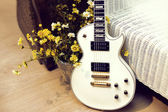 White electric guitar with flowers — Stock Photo