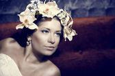 Young beautiful woman dressed as Spring — Stock Photo