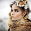Portrait of a beautiful woman wearing fur — Stock Photo