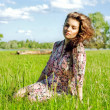 Relaxed young girl sitting on grass in park - Outdoor — Stock Photo