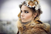 Portrait of a beautiful woman wearing fur — Stock Photo