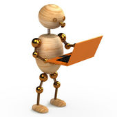 Wood man with orange laptop — Stock Photo