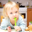 Stock Photo: Child with spoon