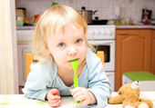 Child with a spoon — Stock Photo