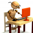 3d wood man working at computer — Stock Photo #4809042