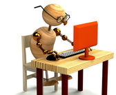 3d wood man working at computer — Stock Photo