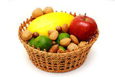 Basket with fruits and nuts — Stock Photo