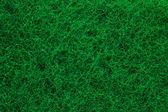 Green abrasive sponge texture background — Stock Photo