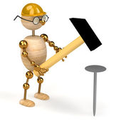3d wood man with a hammer — Stock Photo