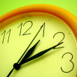 Stock Photo: Yellow wall clock