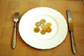 European currency on the white plate — Stock Photo