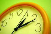 Yellow wall clock — Stock Photo