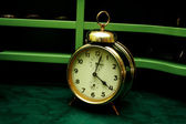 Old gold alarm clock — Stock Photo