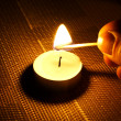Stock Photo: Candle ignition with match