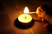 Candle ignition with match — Stock Photo