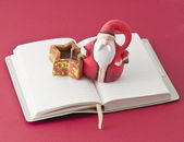 Santa Claus and diary — Stock Photo
