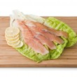 Assorted Trout on light green leaf with lemon — Stock Photo