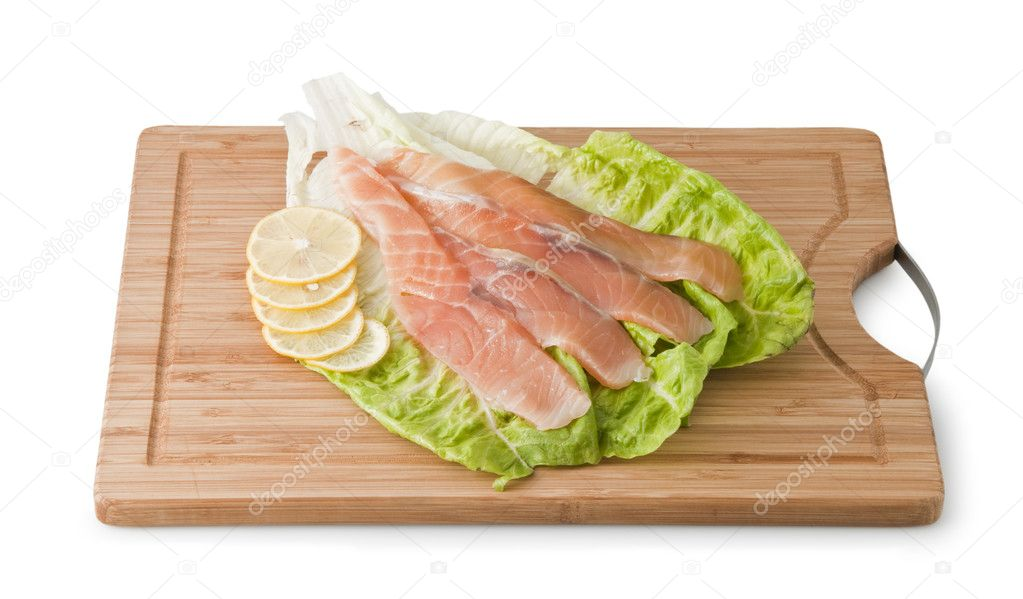 Assorted Trout on light green leaf with lemon isolated on a white background — Stock Photo #4774945