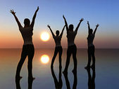 Four girls dancing in the sunrise for freedom — Stock Photo