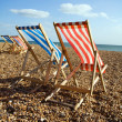 Deckchairs beach sea windy — Stock Photo #4496225