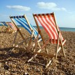 Deckchairs beach sea windy - Stock Photo