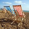 Deckchairs beach sea windy — Stock Photo