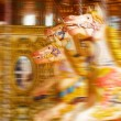 Stock Photo: Carousel horse merry-go-round funfair