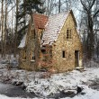 Ruin forest lodge home in winter - Stock Photo