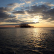Brighton pier sunset waves — Stock Photo