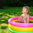 Stock Photo: Paddling pool child
