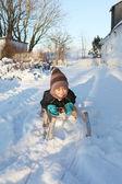 Child on sledge or sleigh winter snow — Stock Photo