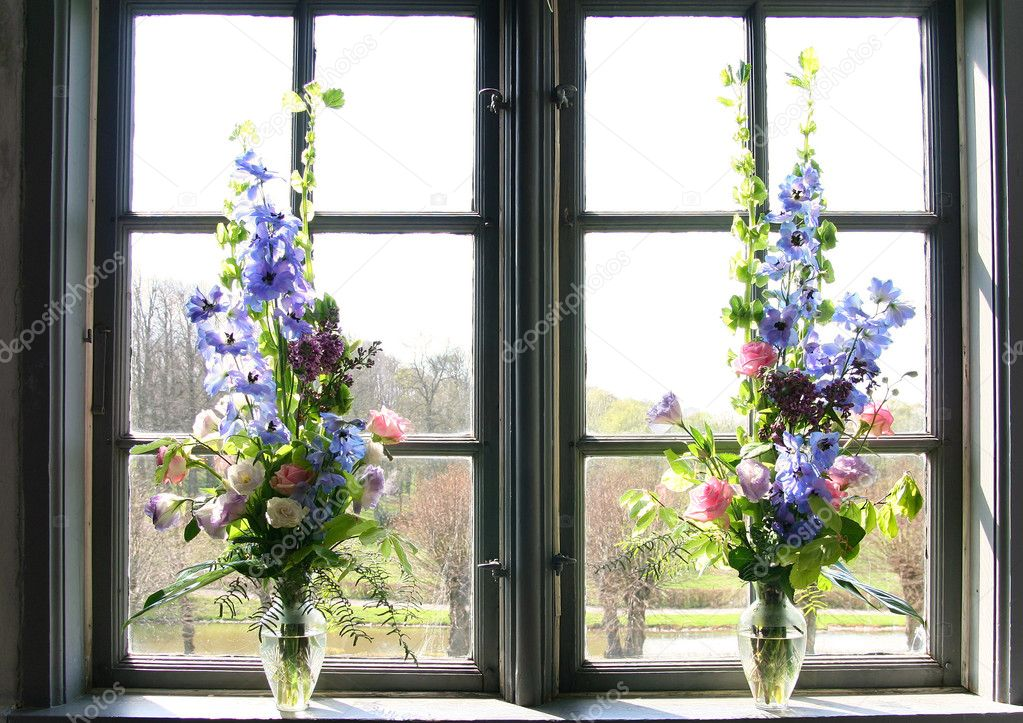 Flower arrangement in window. decorative bouquet of bloom  Stock Photo #4499918