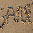 Stock Photo: Sand writting in sand