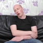 Sleeping sofa man — Stock Photo #4508793