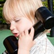 Child telephone playing — Stock Photo #4508824