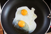 Fried egg on pan — Stock Photo