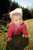 Baby girl garden flowers — Stock Photo