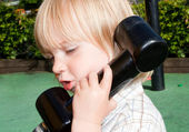 Child telephone playing — Stock Photo