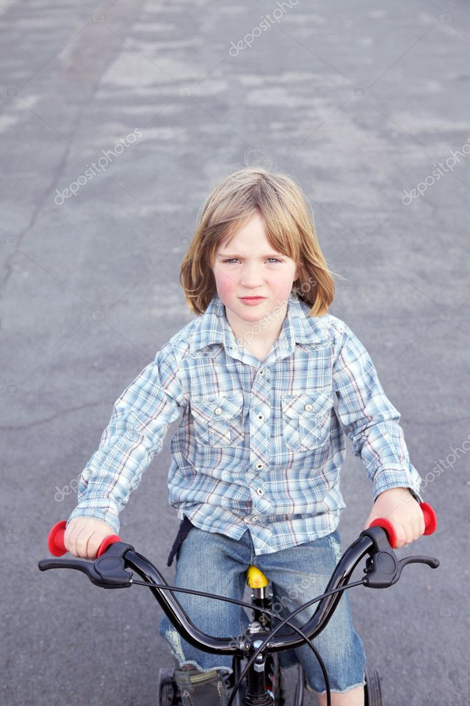 Child cycling on bike. boy playing and exercise on bicycle — Stock Photo #4508428