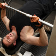 Stock Photo: Training strength barbell gym