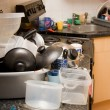 Kitchen dirty mess washing-up - Stock Photo