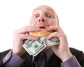 Greed avarice consuming dollars — Stock Photo