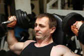 Training triceps weights dumbell — Stock Photo